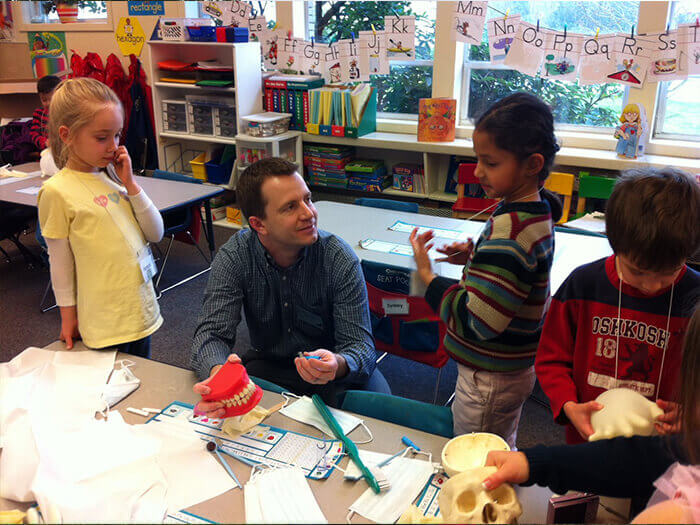 Dr. Brandon Kearbey interacting with children