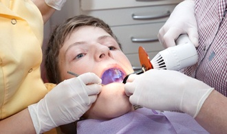 boy receiving treatment from dentist
