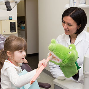 Little girl visiting pediatric dentist