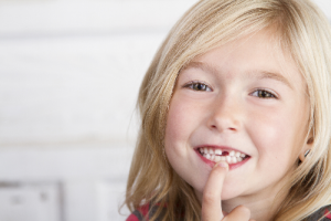 Young girl with missing tooth