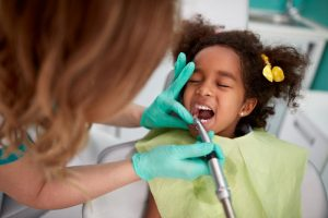 little girl curly hair at dentist