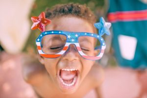 kid wearing patriotic glasses
