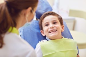 young boy smiling at his special needs dentist in Hillsboro