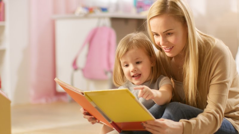 Mother and child reading children's book